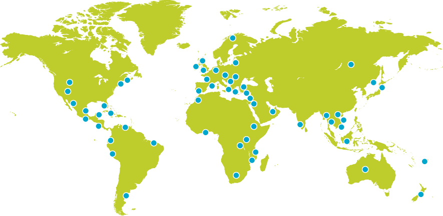 Green world map with blue dots indicating where our students have studied abroad