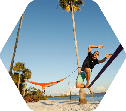 Male student on slack line at South Beach