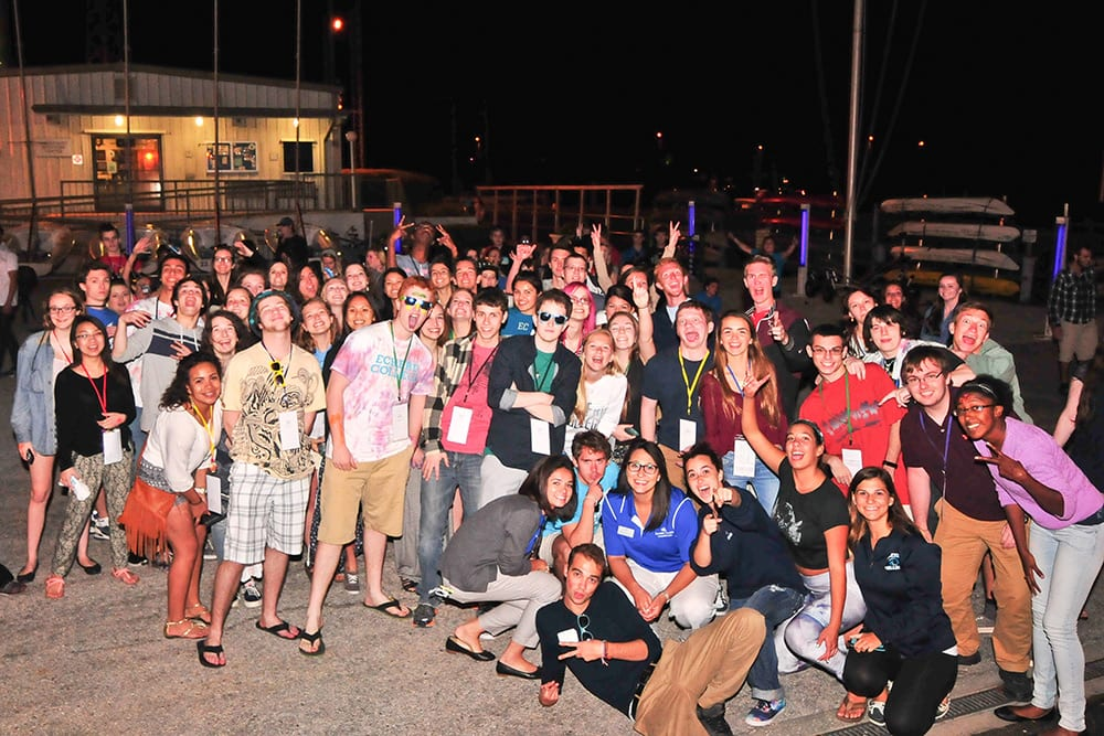 Group of students gathered at night at the Waterfront