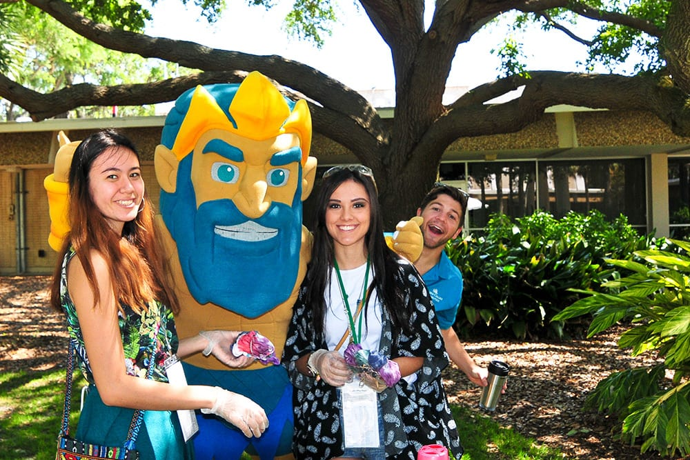 Female students with King Triton mascot