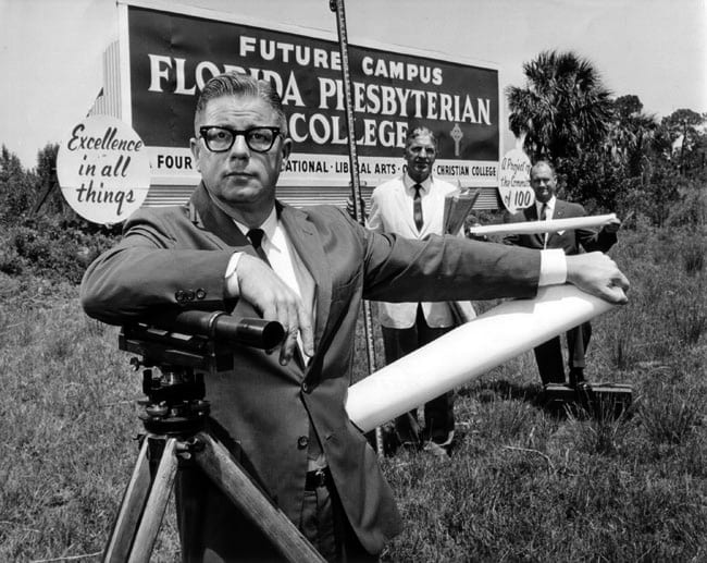 William H. Kadel in front of Florida Presbyterian College sign