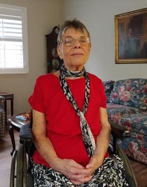 Sue in wheelchair, at home