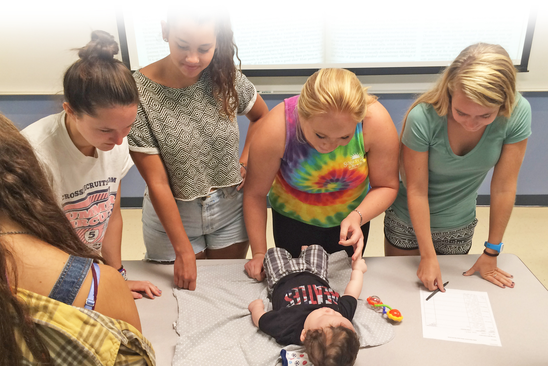 Students studying infant reflexes in Introduction to Human Development