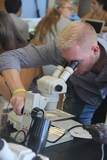 Professor Krediet looking into microscope