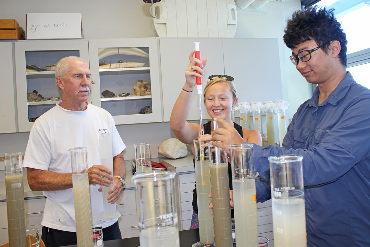 Professor Brooks with students in a lab in Galbraith Marine Science Laboratory at Eckerd College