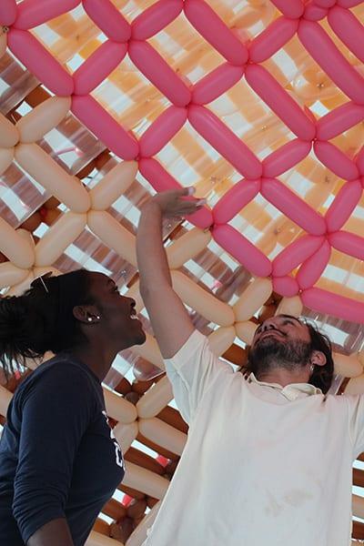 Students inside balloon sculpture