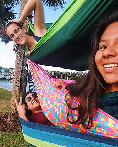 Students hanging out in a hammock