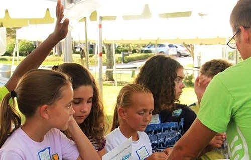 Eckerd students talking to kids at the annual St. Pete Science Festival