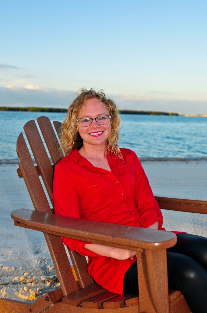 Brittany N. Evans sits in a chair on Eckerd College's South Beach.