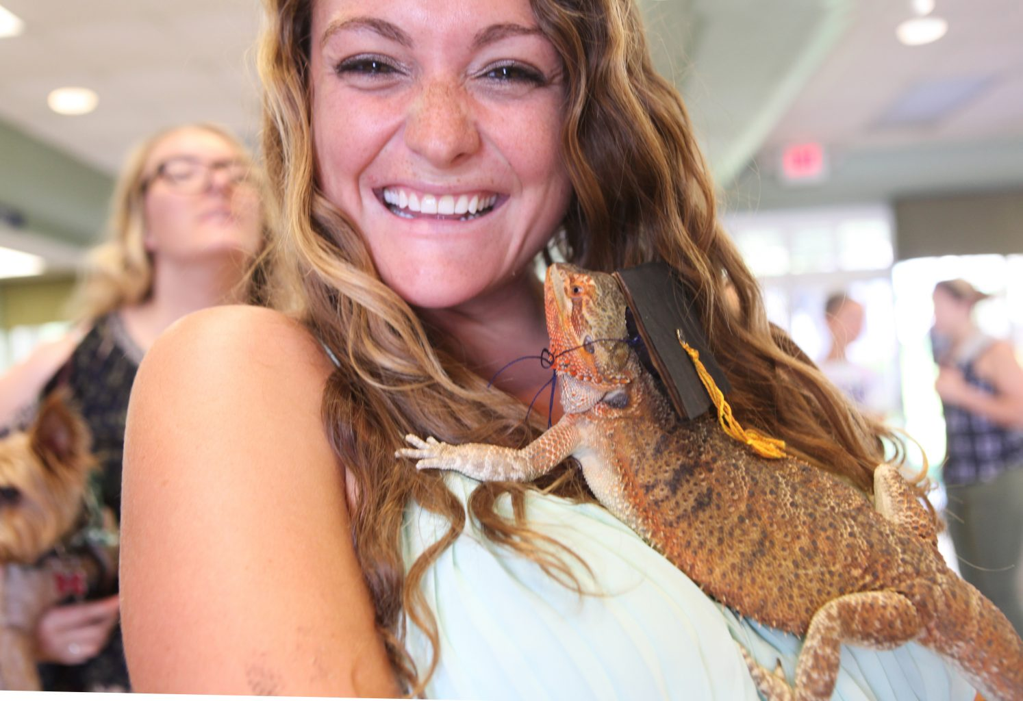 Danielle Becker poses with her pet bearded dragon at pet commencement 2016.