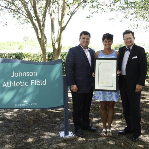 Ian and Maureen Johnson stand with Presdient Eastman on the new Johnson Field.