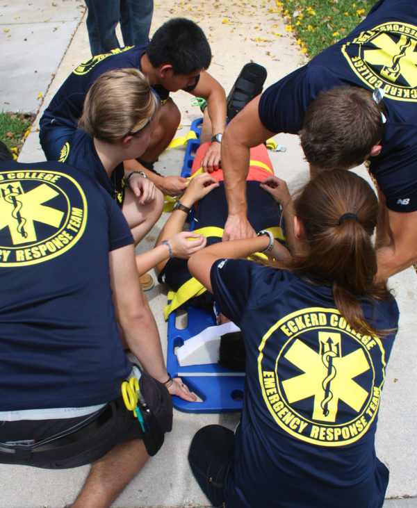 Eckerd College Emergency Response Team members tend to a volunteer during a training simulation.