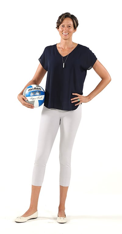 Michelle Piantadosi standing with volleyball under her arm