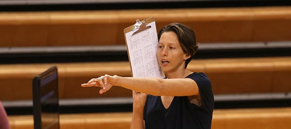 Michelle Piantadosi pointing out strategy to her players during a game