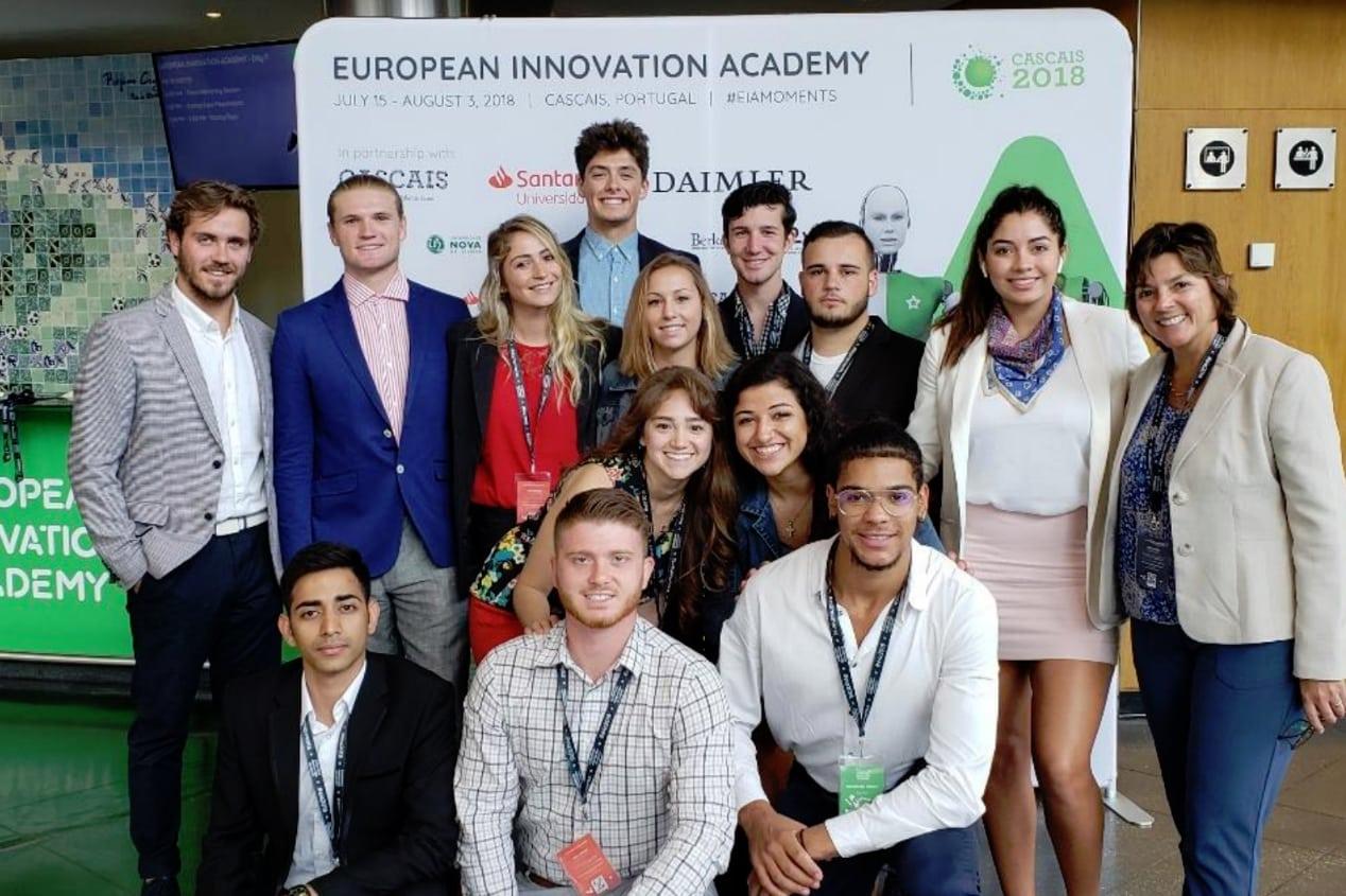 Eckerd College students standing with professor