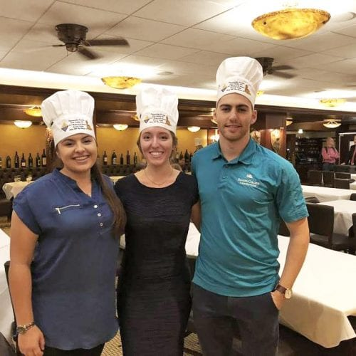 Eckerd students pose after taking second place at the competition