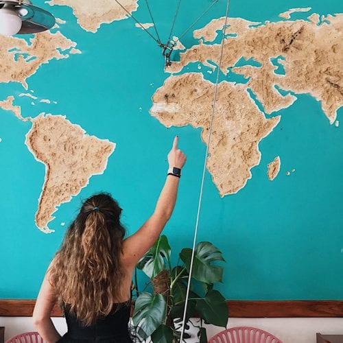 Student looking at a map of the world