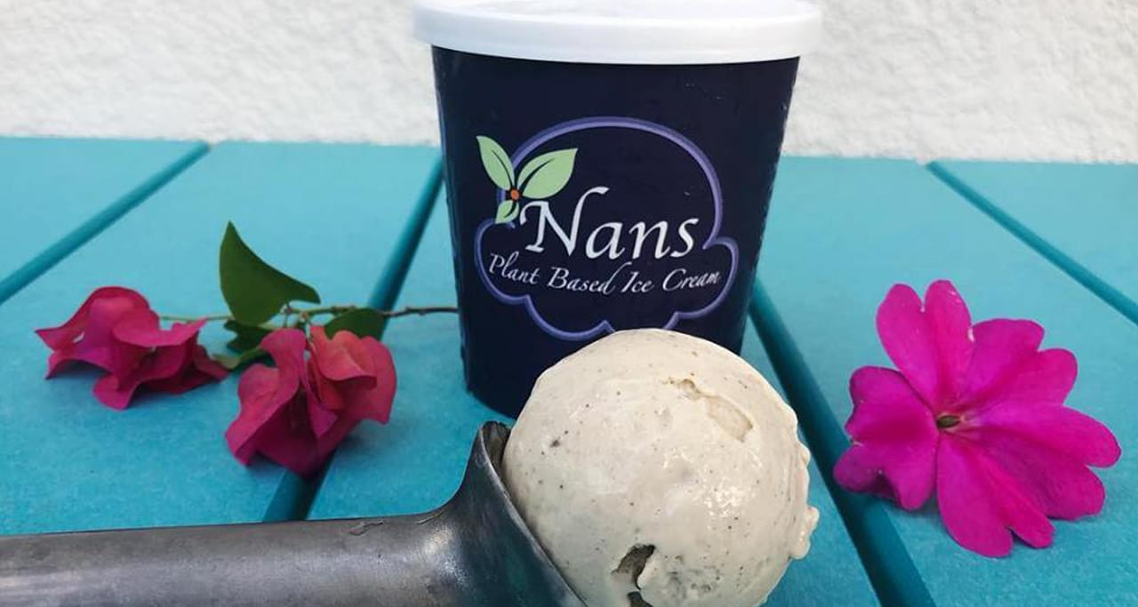 Scoop of ice cream in front of cup with Nans logo