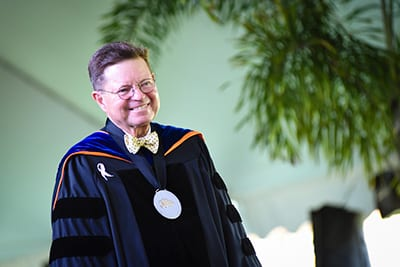 Dr. Eastman smiling, at Commencement
