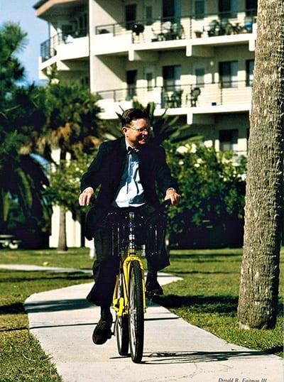 Dr. Eastman on yellow bike