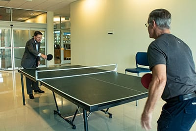 Dr. Eastman playing ping pong