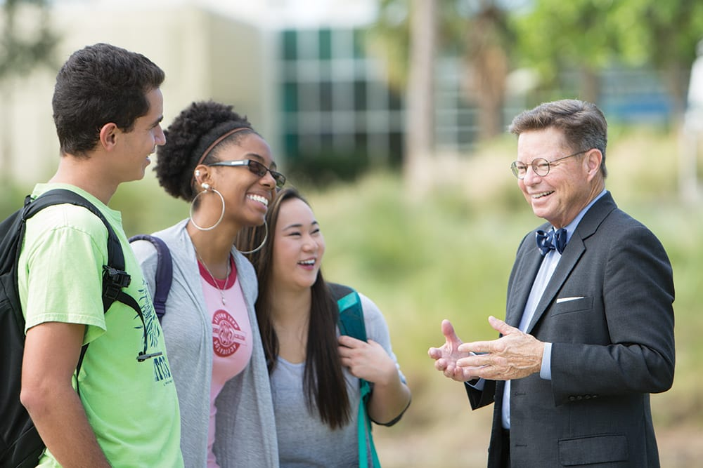 Dr. Eastman laughing with students