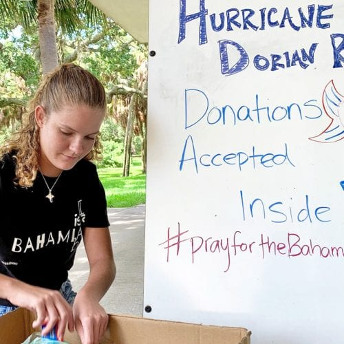 Morgan Bower '22 gathering donations in box