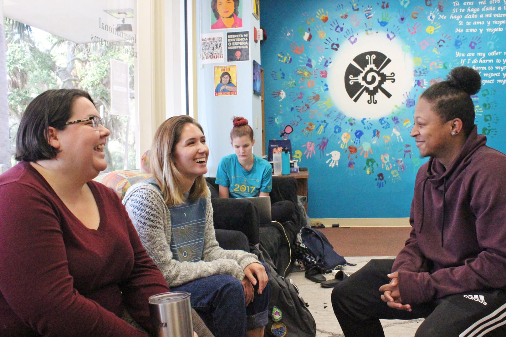First generation students chat with professor Miller