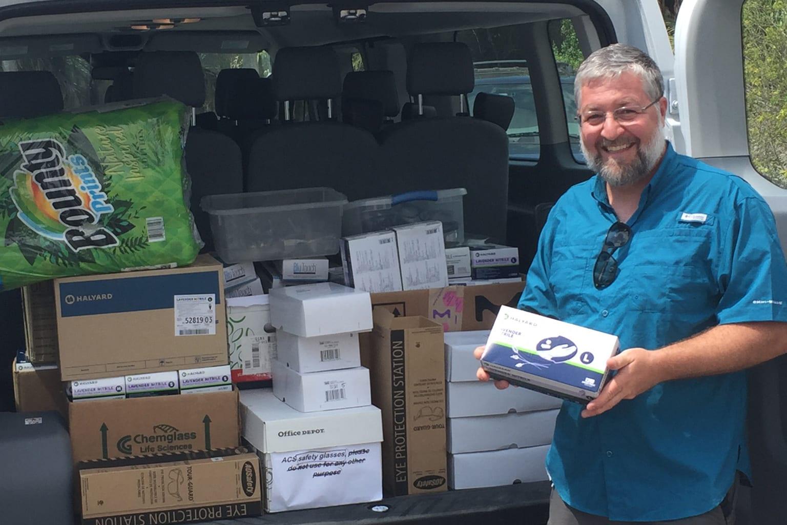 Brian Conlin loads personal protective equipment into a van