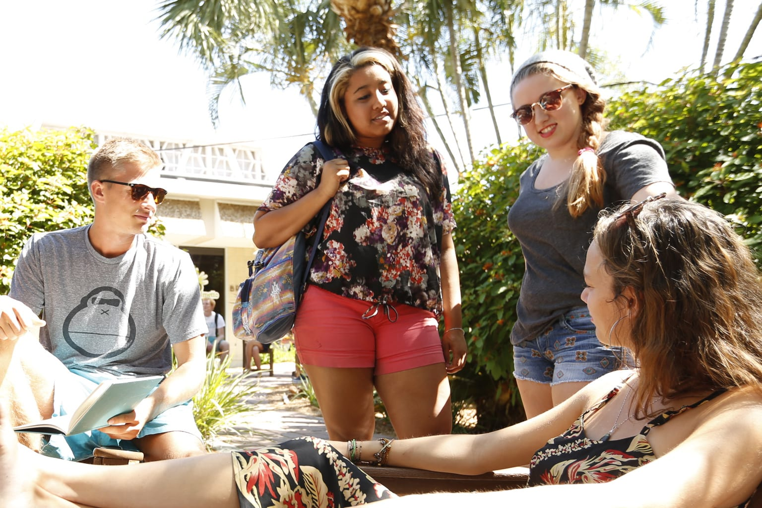 Eckerd students talking together outside