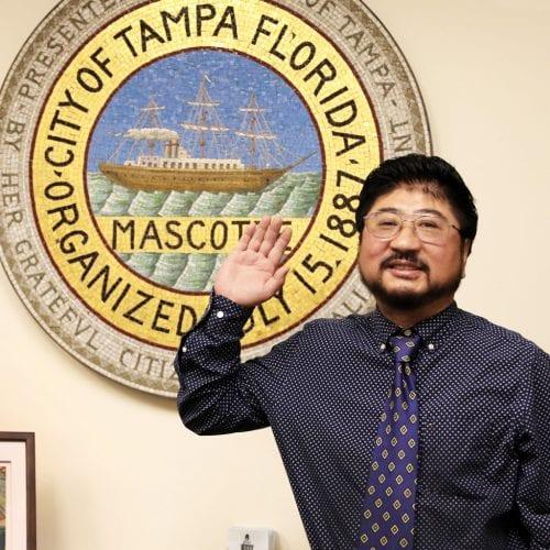 Professor Wang raising his right hand