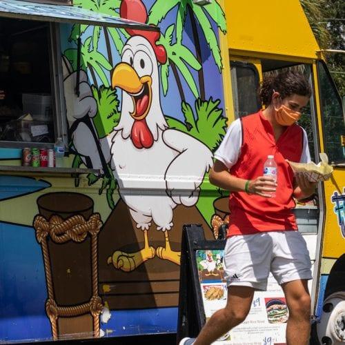 Eckerd student walks away from food truck on campus