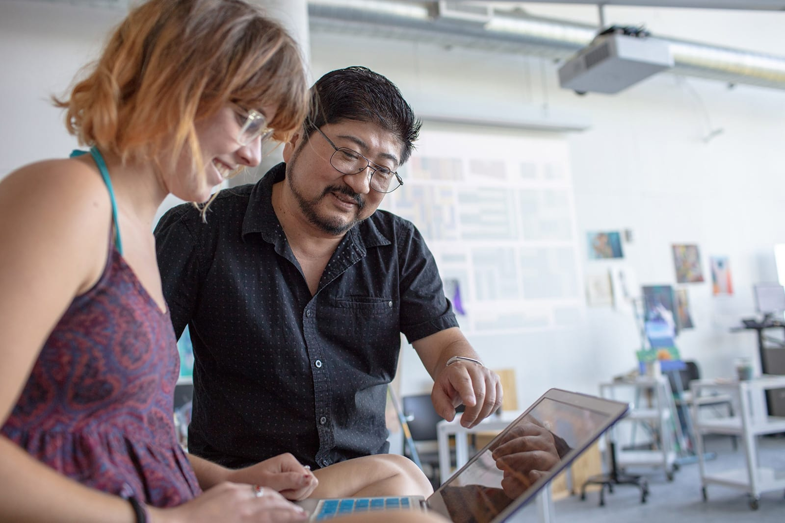 Visual Arts professor Kirk Wang teaching painting to Eckerd student Zoe Turtle '18