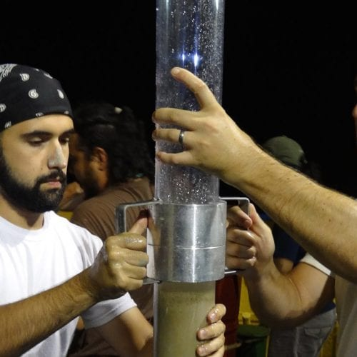 Bryan O'Malley (left) and Patrick Schwing (right) transfer a seafloor sediment core for storage aboard the B/O Justo Sierra, operated by the National Autonomous University of Mexico (photo credit: Devon Firesinger)