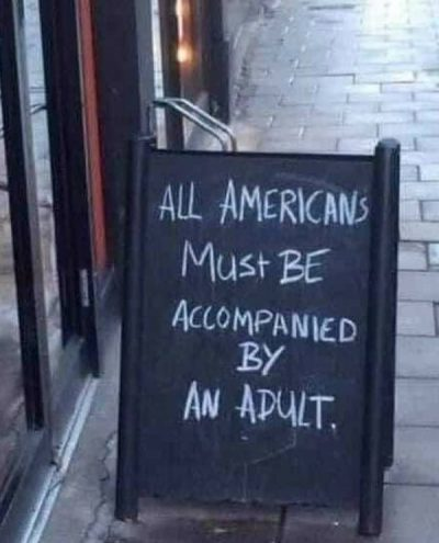All Americans must be accompanied by an adult - sandwich board outside a pub in London