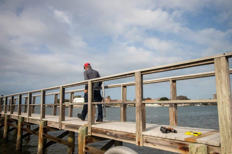 Staff installing wires under Galbraith pier