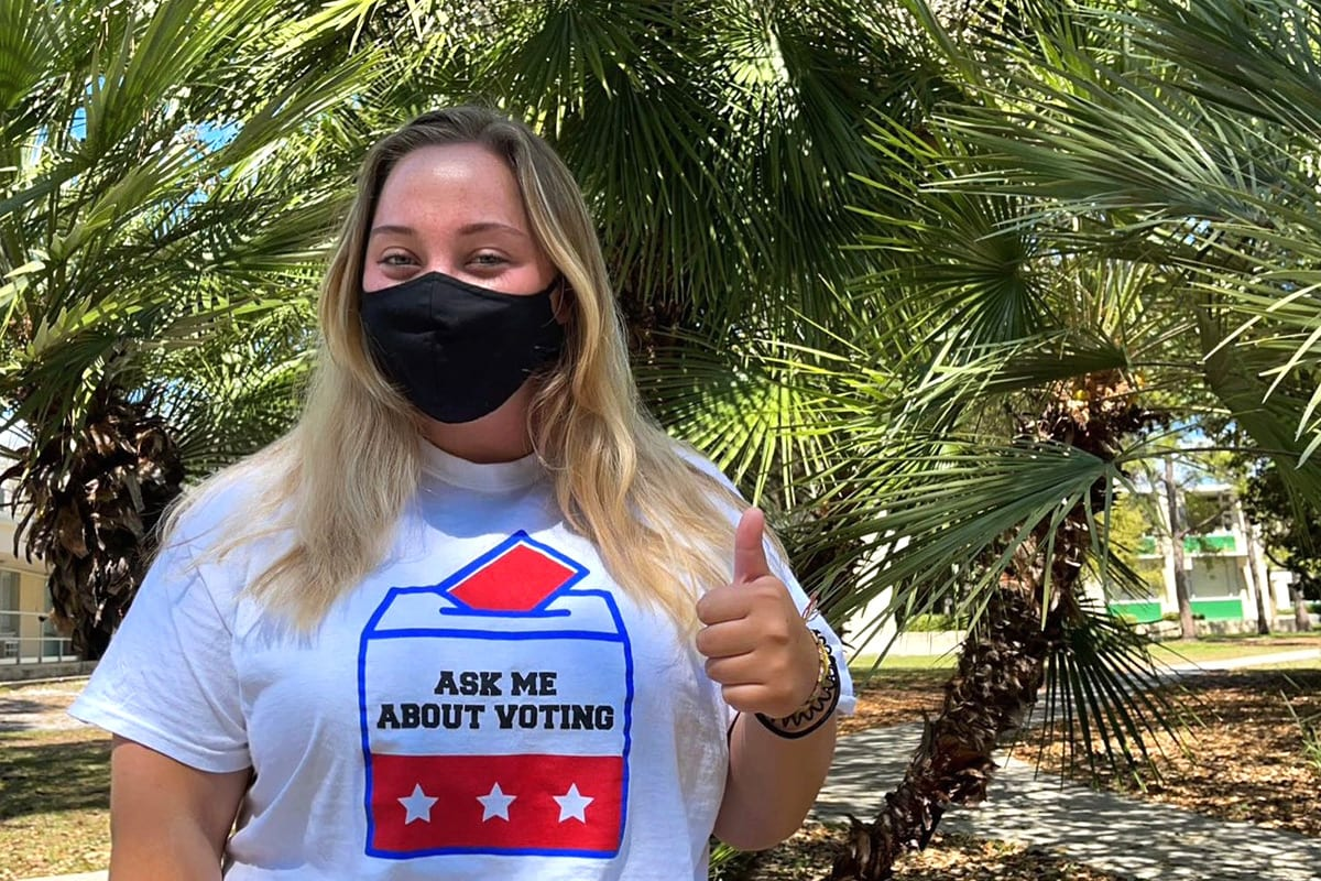 """Student wearing """"Ask me about voting"""" shirt"""