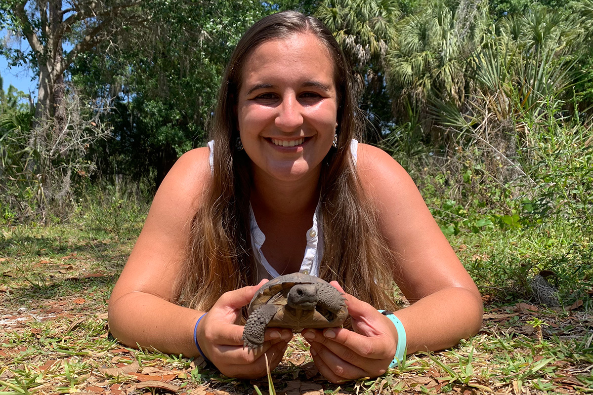 Student holds a baby Gopher Tortoise
