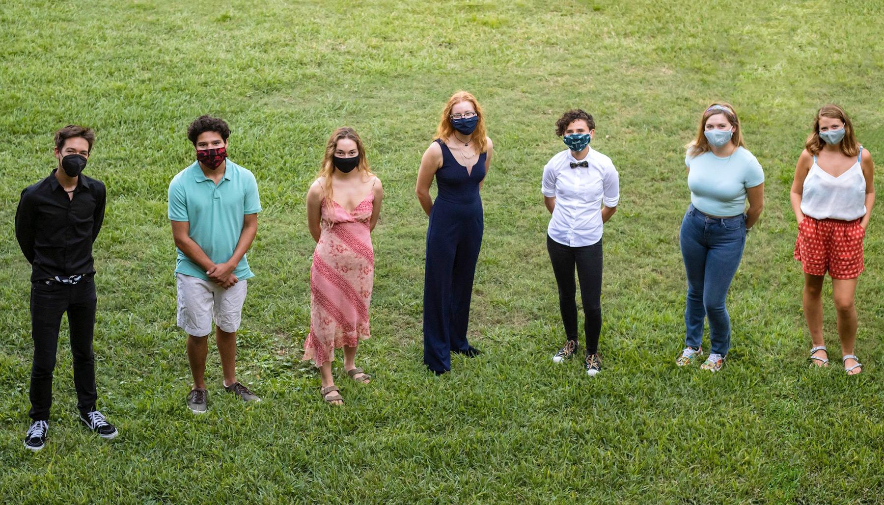 Seven Hollings Scholars from Eckerd College standing in grass