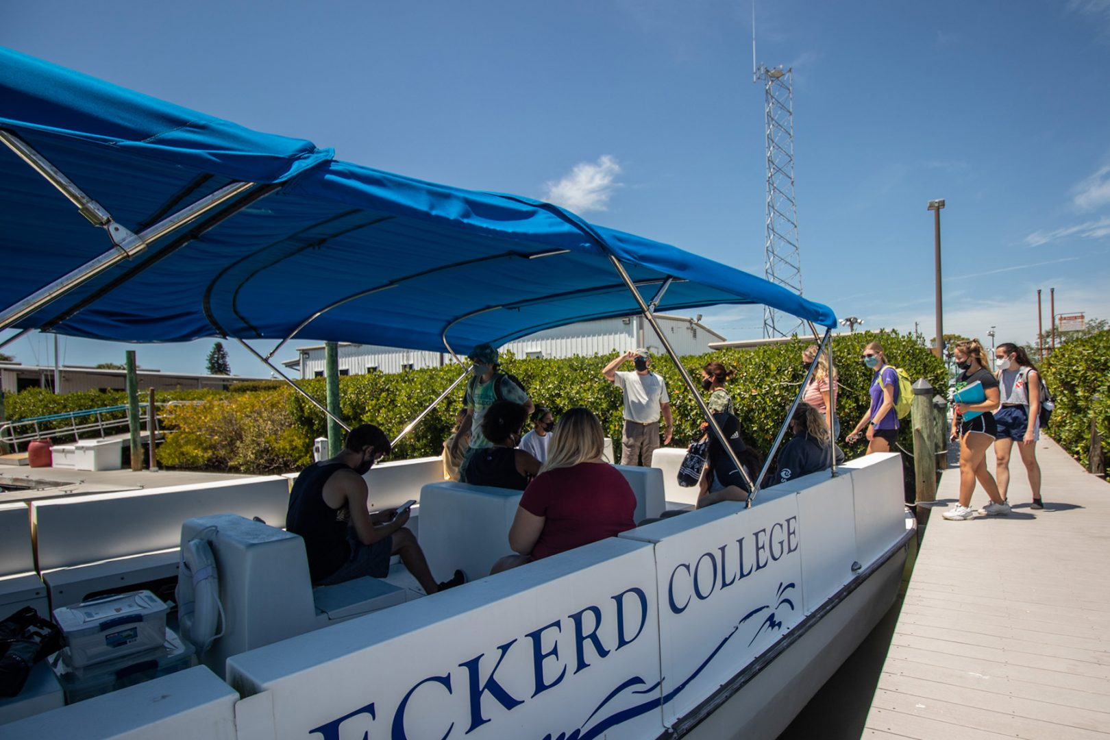 Students getting on board a research vessel