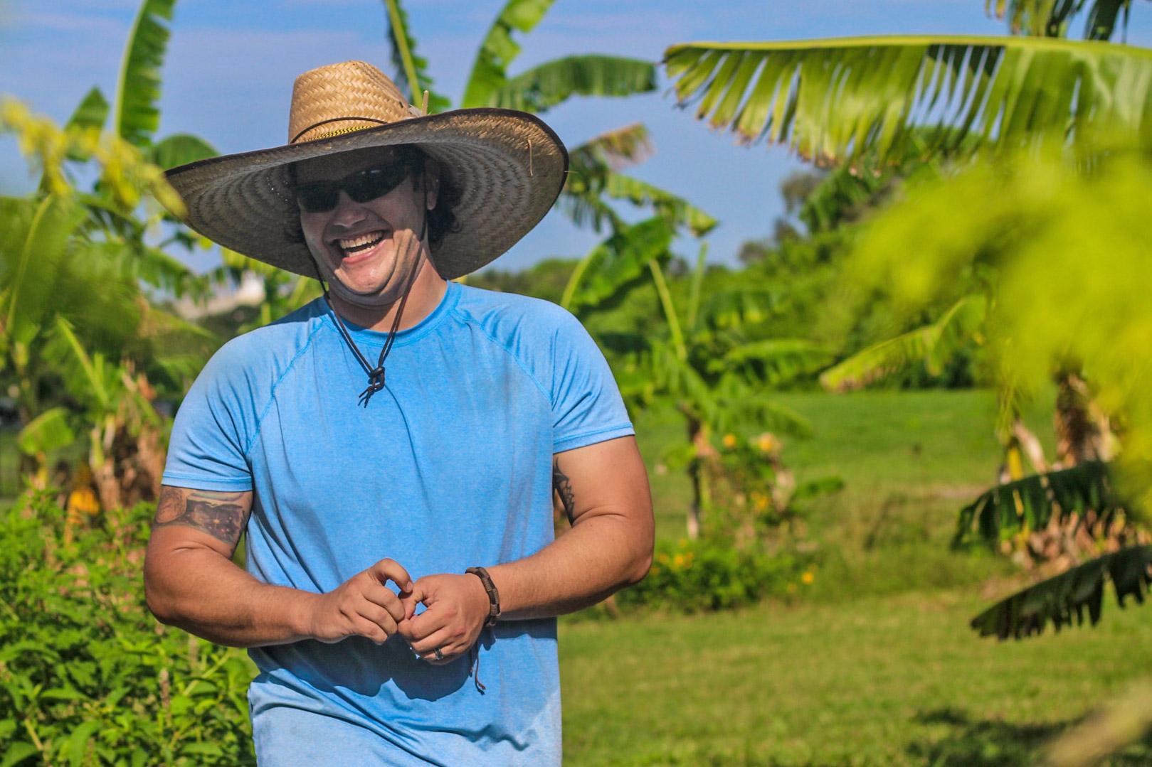 Jonathan Prieto in the Eckerd College community farm