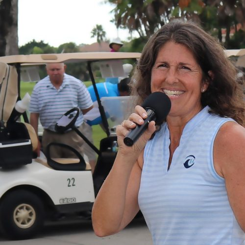 Sue McDermott emcees at memorial golf tournament