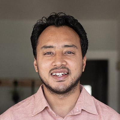 Rupak smiles at camera
