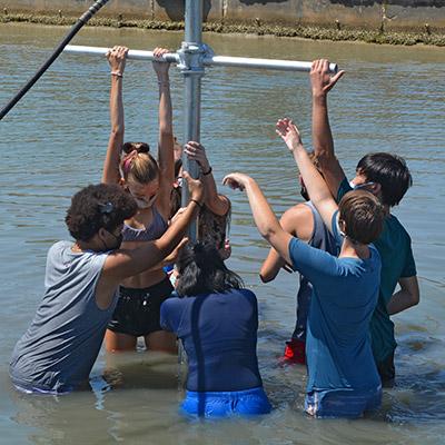 Eckerd College marine science students sample sediment on the seafloor