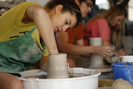 Students at pottery wheel