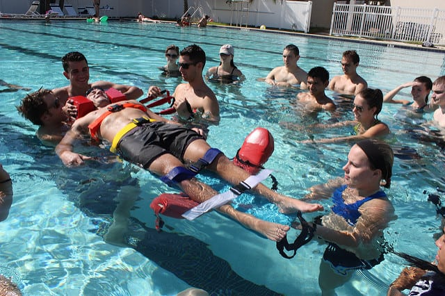 Eckerd College Emergency Response Team students perform a drill in the pool