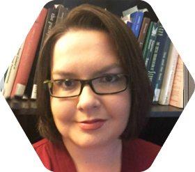 Lisa Miller in front of book shelf