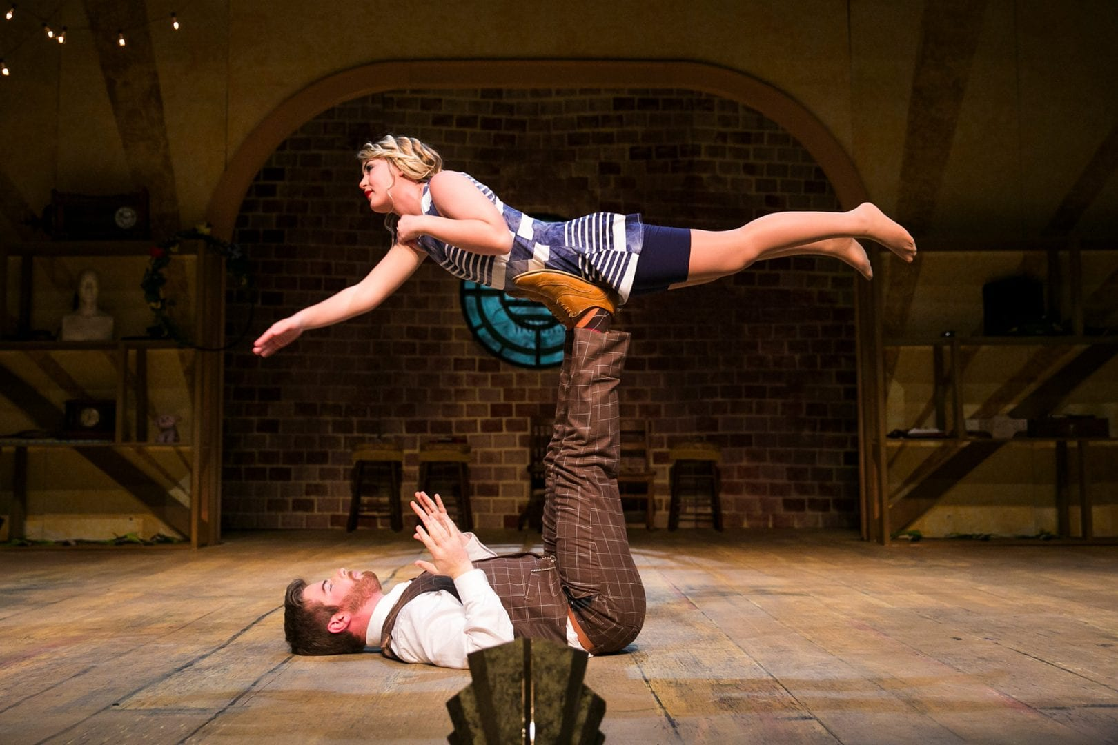 Male actor holds up female actress with his legs in Failure: A Love Story