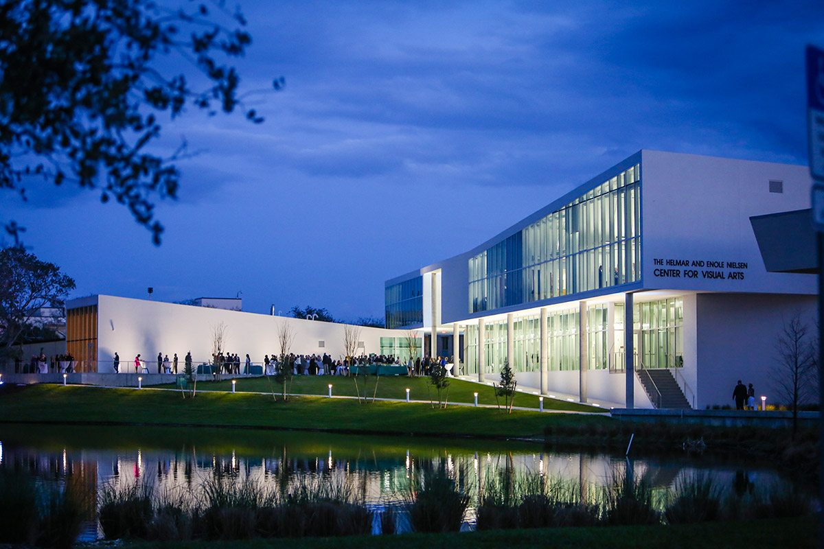 The Nielsen Center for Visual Arts viewed at night from across pond