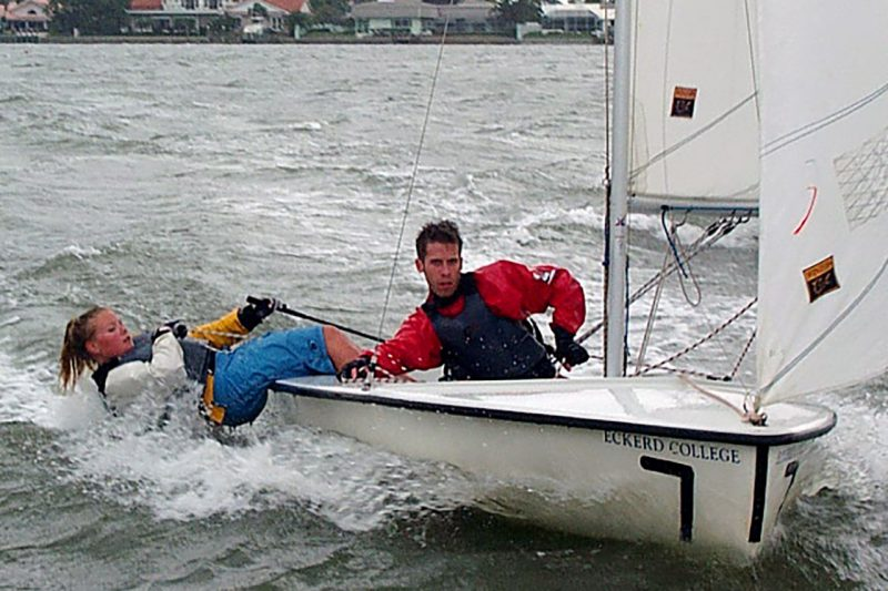 Students practicing drills on small sailboat